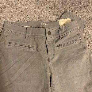 Gray LOFT skinny jeans- never worn! Size 30/10